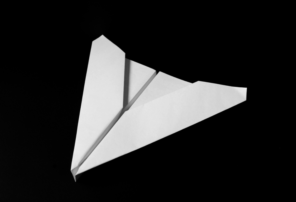 How to make a paper plane - delta wing.  Instructions and video tutorials via http://PaperPlaneDepot.com